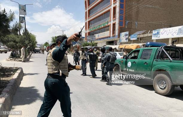 Afghan security forces inspect the scene after gunmen attack to Medicins Sans Frontieres clinic in DashteBarchi region of Kabul Afghanistan on May 12...