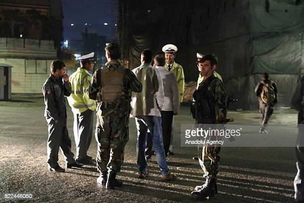 Afghan security forces inspect the scene of a blast after a bomb placed near a road close to the house of Afghan Vice President Abdul Rashid Dostum...
