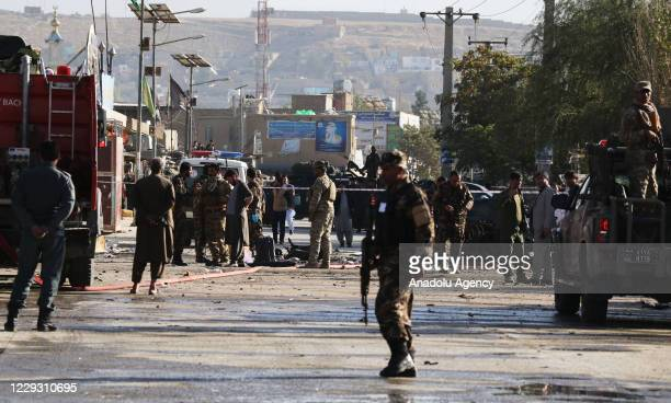 Afghan security forces inspect the scene of an explosion in Kabul, Afghanistan on October 27, 2020. At least three people were killed and thirteen...