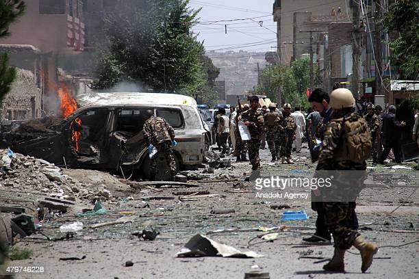 Afghan security forces inspect the site of a bomb blast that targeted NATO forces in Kabul on July 7 2015 A suicide car bomber slammed into a convoy...
