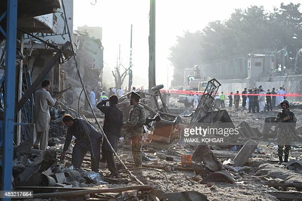 Afghan security forces inspect the site of a powerful truck bomb in Kabul on August 7 2015 A powerful truck bomb killed at least seven people and...