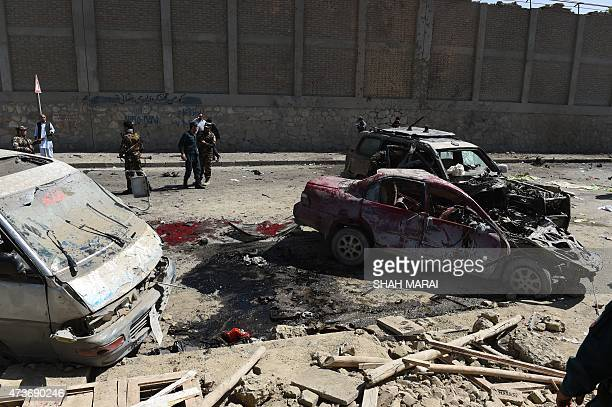 Afghan security forces inspect the site of a suicide attack in Kabul on May 17 2015 A powerful suicide blast struck near Kabul airport during the...