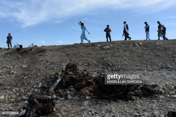 Afghan security forces inspect the site of a suicide attack targeting foreign troops in the Bati Kot district of Nangarhar province on May 1 2017 A...