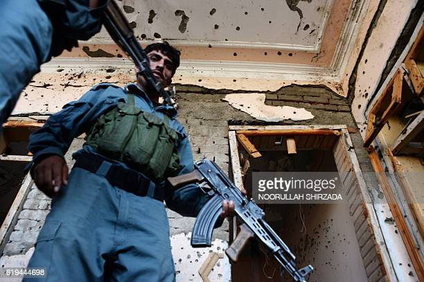 TOPSHOT Afghan security forces inspect the site of a suicide bombing that targeted a gathering of the local tribal elders in Chaparhar district of...