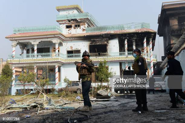 Afghan security forces inspect the site of an attack by Islamic State militants at the British charity Save the Children compound in Jalalabad on...