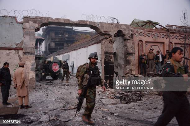 Afghan security forces inspect the site of attack on British charity Save the Children office in Jalalabad on January 24 2018 Save the Children...