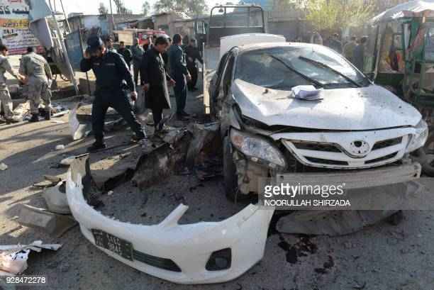 Afghan security forces inspect the site of suicide attack in Jalalabad on March 7 2018 A suicide bomber has killed at least three people including a...