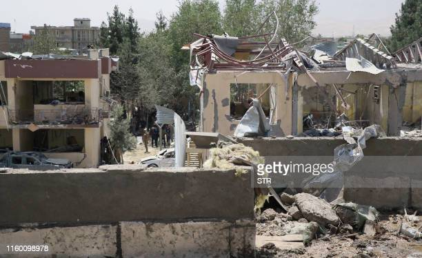 Afghan security forces investigate the site where a Taliban car bomb detonated at the entrance of a police station in Kabul on August 7 2019 Scores...