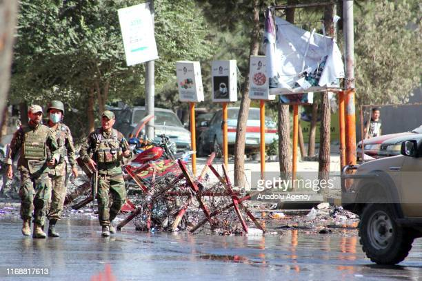 Afghan security forces keep watch at the site of a suicide attack in Kabul Afghanistan on September 17 2019 near the US Embassy and government...