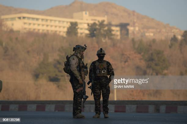 Afghan security forces keep watch near the Intercontinental Hotel following an attack in Kabul on January 21 2018 Gunmen killed at least five people...