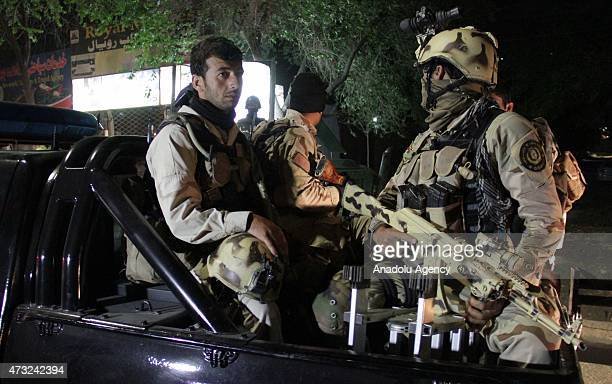 Afghan security forces on patrol around the Park Palace guesthouse in Kabul on May 14 2015 An American and two Indian citizens were among the five...