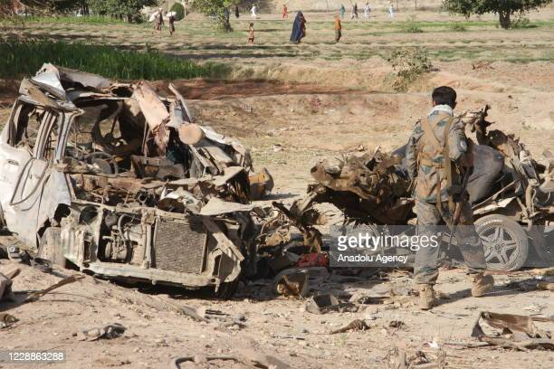Afghan security forces on the scene after a car bomb attack that targeted a government building, in the Ghani Khel district of Nangarhar province,...
