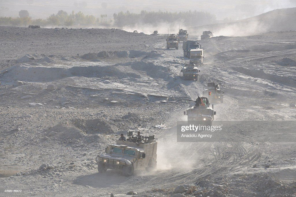 Afghan security forces patrol the area during the clash against Taliban militants in Nanhargar district of Kabul, Afghanistan, on November 24, 2014. At least 35 Taliban militant were killed by Afghan forces.