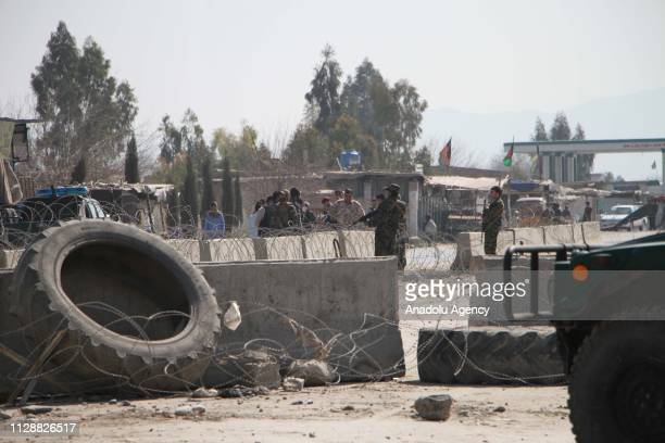 Afghan security forces secure the road leading to the scene of a suicide bomb attack near the airport in Jalalabad, Afghanistan, 06 March 2019. A...