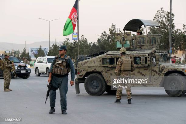 Afghan security forces secure the site of multiple explosions targeted a political gathering where Amrullah Saleh the first voice president candidate...
