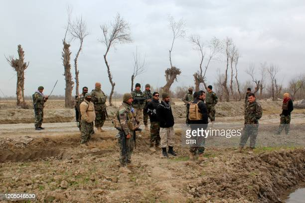Afghan security forces stand guard after an attack by Taliban militants near an Afghan National Army outpost, in Kunduz Province on March 4, 2020. -...