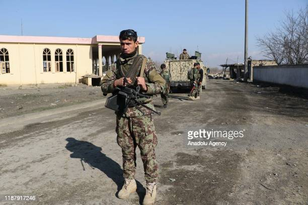 Afghan security forces stand guard at the scene of a car bombing near the US Bagram Air Base in Bagram, Afghanistan, 11 December 2019.