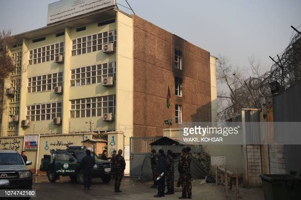 Afghan security forces stands guards at the Ministry of Public Works a day after a deadly militant attack in Kabul on December 25 2018 An hourslong...