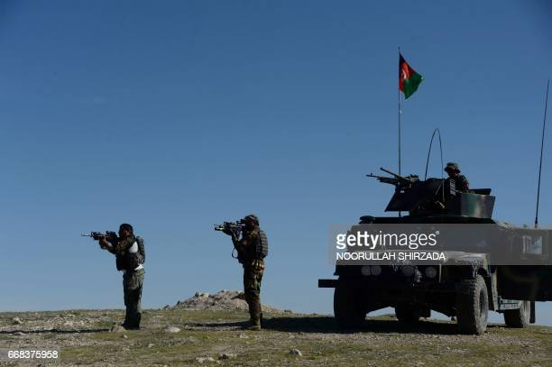 TOPSHOT Afghan security forces take part in an ongoing operation against Islamic State militants in the Achin district of Afghanistan's Nangarhar...