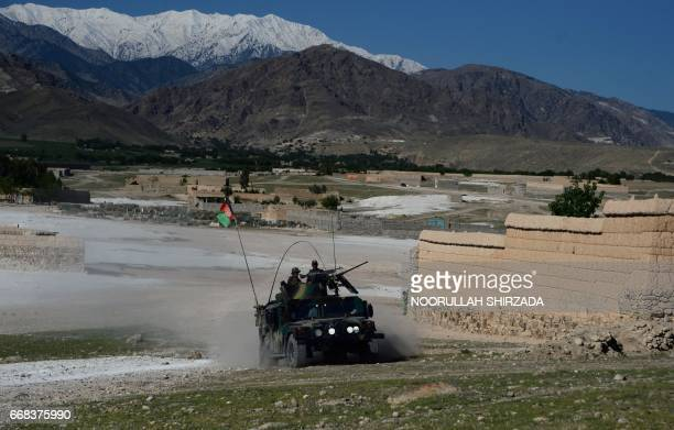 Afghan security forces take part in an ongoing operation against Islamic State militants in the Achin district of Afghanistan's Nangarhar province on...