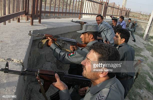 Afghan security forces take position during the clashes between a group of Taliban militants and Afghan policemen at Kabul international airport on...