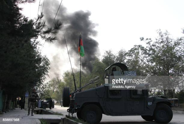 Afghan security forces take positions near a Shiite Muslim mosque after an attack during Friday prayer in Kabul Afghanistan on August 25 2017