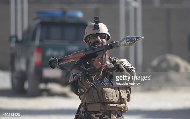 Afghan security forces take security measures after a bomb attack staged with a bombladen motorbike and killed 4 foreign security guards and wounded...