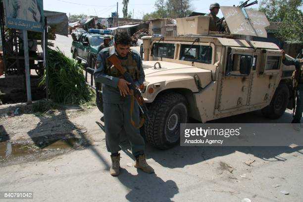 Afghan security forces take security measures at the scene of suicide attack on MP Zahir Qadir's house in Jalalabad the capital of Nangarhar province...