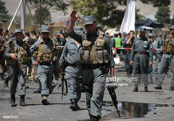 Afghan security guards inspect the site of a suicide attack targeting the Kabul international airport Afghanistan 10 August 2015 A suicide bomber...