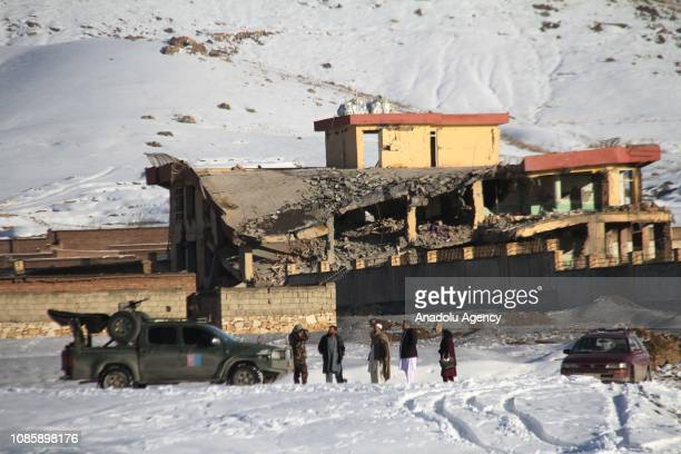 Afghan security officers secure the area of a collapsed building of National Directorate of Security in central Maidan Wardak province Afghanistan on...