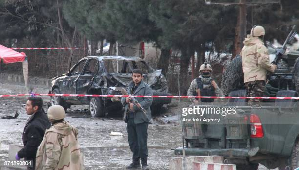 Afghan security officials inspect the explosion site after a suicide attack in front of a wedding hall in Kabul Afghanistan on November 16 2017