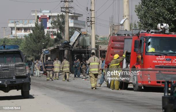 Afghan security officials inspect the explosion site that targeted security forces in Kabul Afghanistan on July 26 2018 At least five Afghan...
