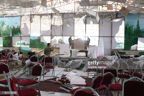 Afghan security officials inspect the scene after an overnight suicide bomb blast that targeted a wedding reception in Kabul Afghanistan on August 18...
