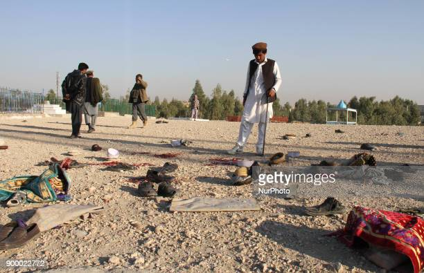 Afghan Security officials inspect the scene of a bomb blast that targeted the funeral of a former district governor on the outskirts of Jalalabad...