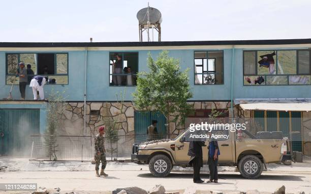 Afghan security officials inspect the scene of a suicide attack targeting a gathering of contractors outside the gate of the Afghan Special Forces...