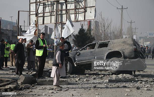 Afghan security officials inspect the side after an explosion in Kabul Afghanistan on December 28 2016 At least 5 persons were injured when a bomb...