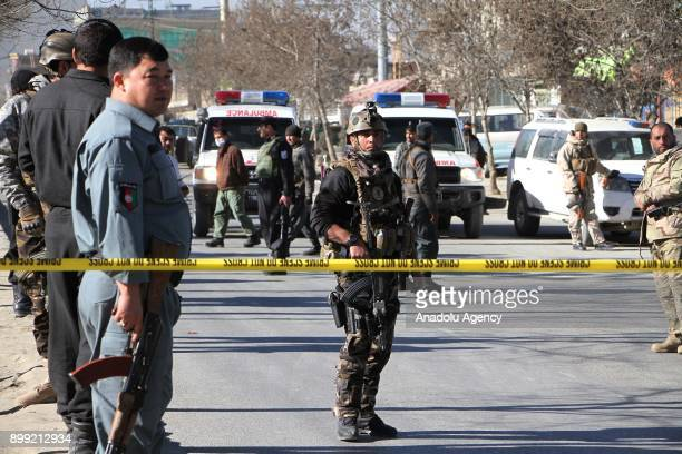 Afghan security officials inspect the site after triple blast in Kabul Afghanistan on December 28 2017 At least 40 people had been killed and 30...