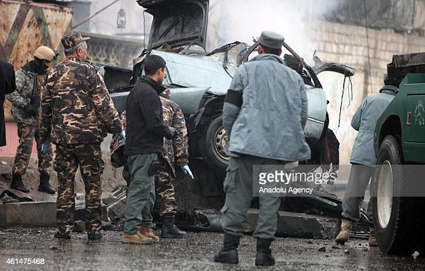 Afghan security officials inspect the site of a bomb blast, in Kabul, Afghanistan, 13 January 2015. A suicide car bomber has struck near the...