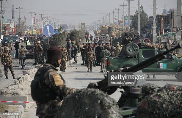 Afghan security officials inspect the site of a suicide bomb attack on a British embassy vehicle on November 27, 2014 in Kabul, Afghanistan....