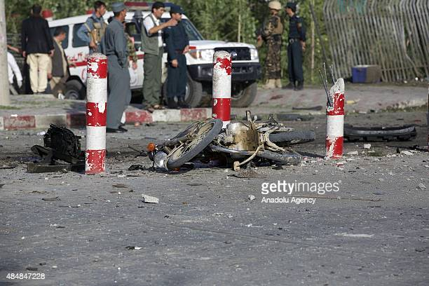 Afghan security officials inspect the site of a suicide bomb blast that targeted the NATO convoy troops in Kabul, Afghanistan on August 22, 2015. A...