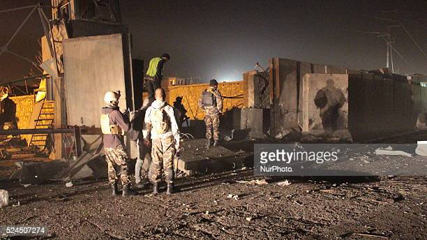 Afghan security officials inspect the site of a suicide car bomb attack at the gate of Green Village foreign compound in Kabul Afghanistanon November...