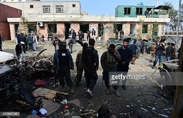 Afghan security personnel are pictured at the scene of a suicide bombing in Sarobi district of Kabul province on February 21 2014 Three male suicide...