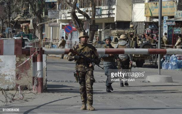 Afghan security personnel arrive at a site after a car bomb exploded near the old Ministry of Interior building in Kabul on January 27 2018 An...