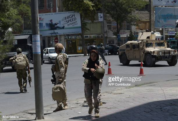 Afghan security personnel arrive at the site of a suicide blast near Iraq's embassy in Kabul on July 31 2017 A series of explosions and the sound of...