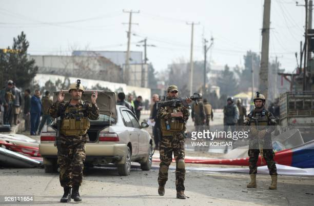 TOPSHOT Afghan security personnel arrive at the site of a suicide car bomb attack targeting foreign forces in Kabul on March 2 2018 A strong blast...