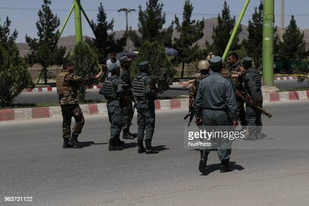 Afghan Security personnel arrive at the site of an attack in the Afghan Interior Ministry in Kabul Afghanistan on May 30 2018 At least one policeman...