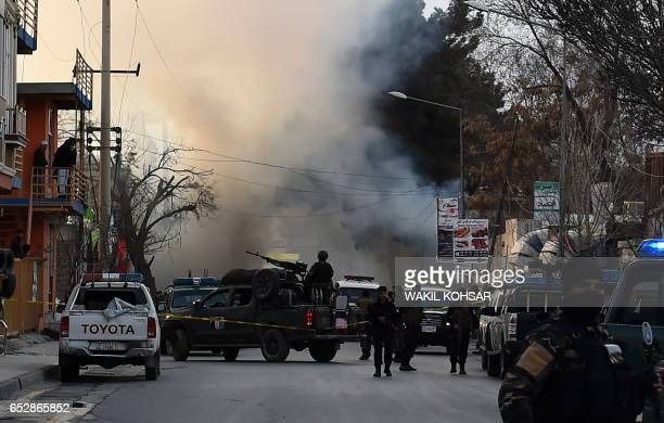 Afghan security personnel arrive at the site of an explosion in Kabul on March 13 2017 A powerful explosion struck a bus in downtown Kabul during...