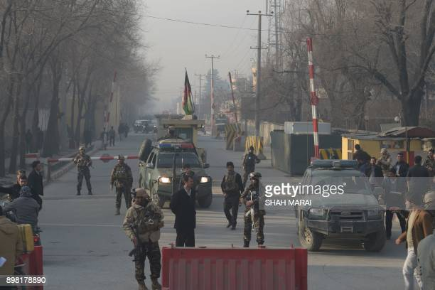 Afghan security personnel block a road near the site of a suicide attack in Kabul on December 25 2017 A suicide attacker on foot blew himself up near...