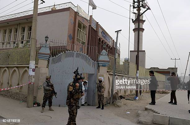 Afghan security personnel gather after a massive suicide blast at a Shiite mosque in Kabul on November 21 2016 A massive suicide blast at a Shiite...