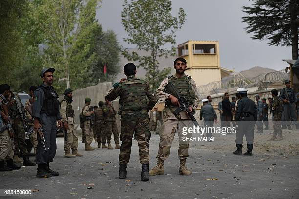 Afghan security personnel gather at the site of a suicide car bomb attack in Paghman district 21 kms west of the capital Kabul on September 16 2015 A...